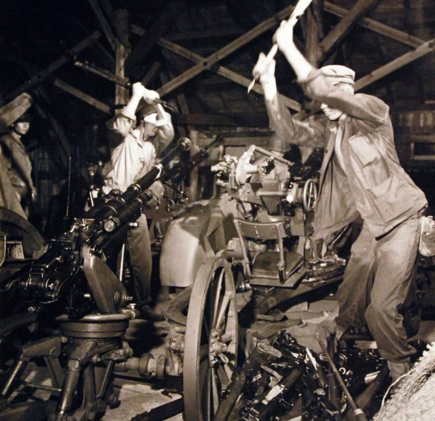 80-G-490441-Surrender-U.S.-Marines-at-Futtsusaki-Point-near-Yokosuka-Naval-Base-Japan-destroy-Japanese-small-arms-in-the-first-step-toward-disarming-the-Japanese.-Released-August-30-1945